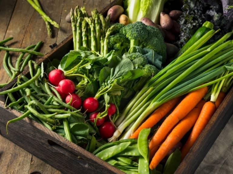 wooden box full of vegetables